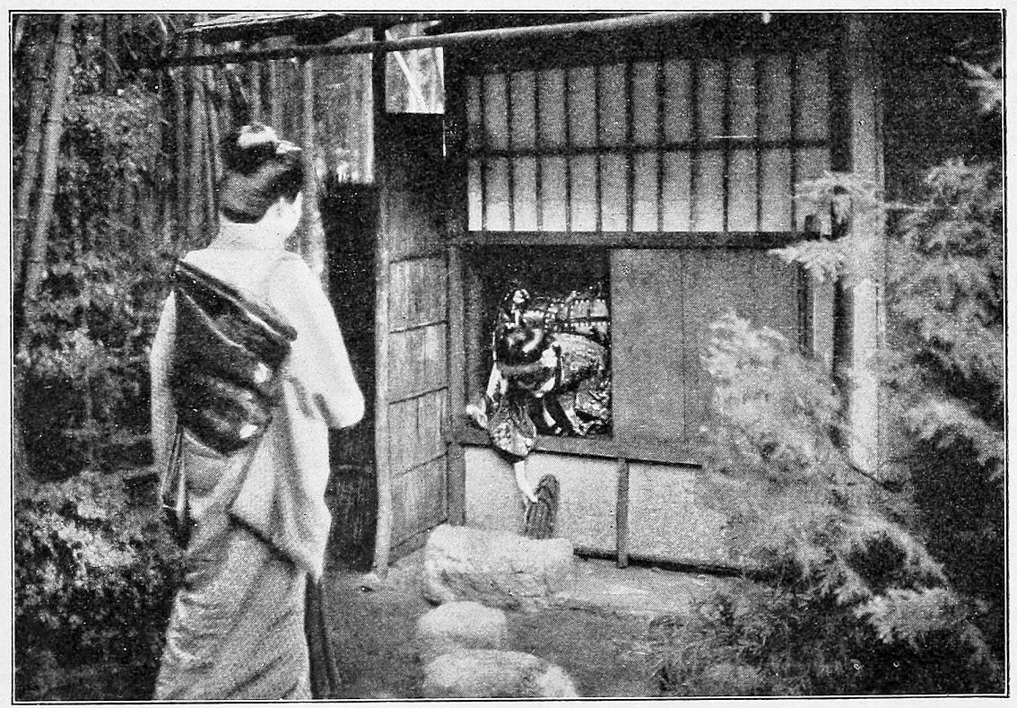Två personer går in i ett japanskt tehus